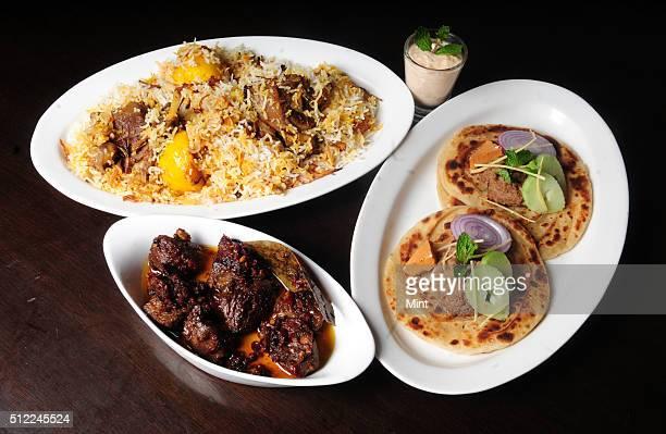 Lucknowi Bengali dishes The Ghutwan Kabab The Nawabi Mutton Biryani Khade Masale Ka Gosht at Ta'aam Restaurant on February 20 2015 in Kolkata India