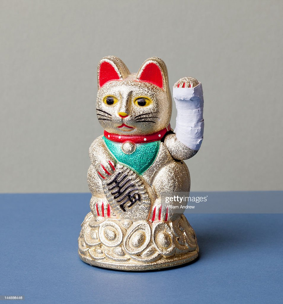 Lucky cat with broken arm : Stock Photo
