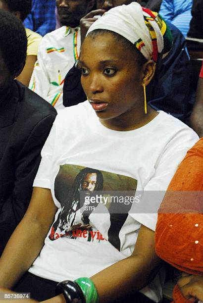 Lucky Dube's daughter Nonkululeko Zanele wearing a short portraiting slain music star Lucky Dube sits before the handing down of judgement of Sifiso...