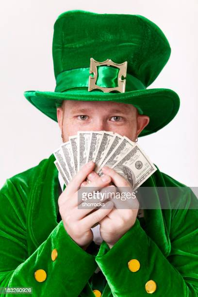 Lucky Leprechaun Peeks from Behind Money