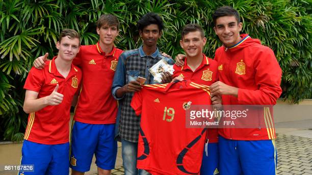 A lucky local fan meets Sergio Gomez Juan Miranda Nacho Diaz and Ferran Torres of Spain during the FIFA U17 World Cup India 2017 tournament at the...