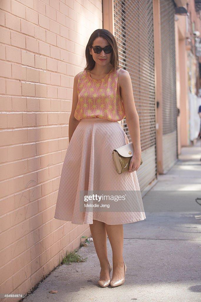 Lucky Magazine Senior Digital Editor Elana Fishman wears a Jill Start top HM skirt Loeffler Randall sandals Warby Parker sunglasses and a vintage...