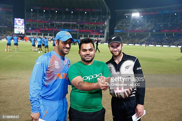 A lucky OPPO mascot has the chance to take a selfie with MS Dhoni Captain of India and Kane Williamson Captain of New Zealand during the ICC World...