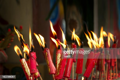Lucky red candles on chinese new year day in temple : Stock Photo