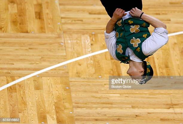 Lucky the Boston Celtics mascot practices flipping off of a trampoline before the start of Game 3 of the Eastern Conference first round playoff...