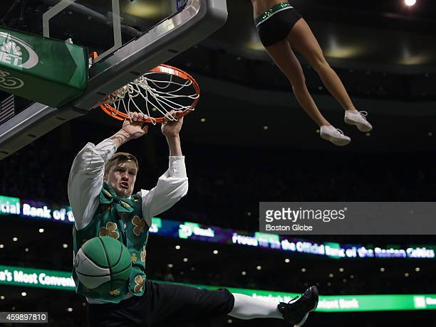 Lucky the Celtics mascot performed a dunk under a high flying Celtic cheerleader during a timeout The Boston Celtics take on the Cleveland Cavaliers...