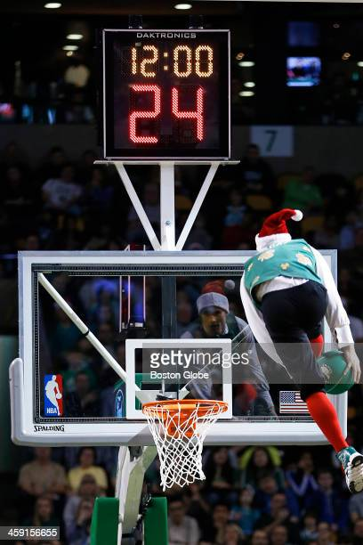 Lucky the Leprechaun made a through the legs dunk off of a trampoline The Boston Celtics play the Washington Wizards at the TD Garden during a...