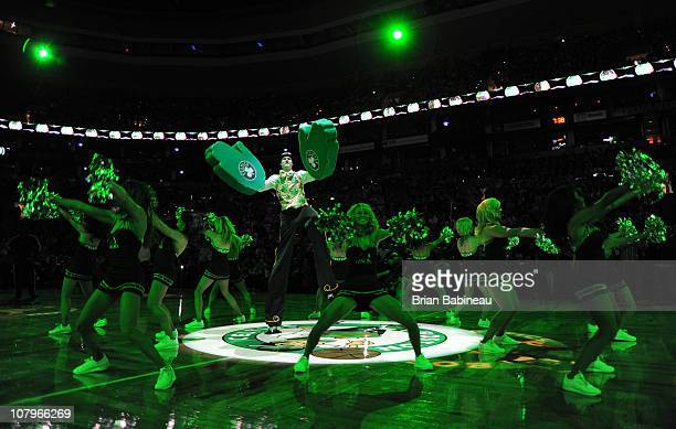 Lucky the mascot and the Celtics Dancers get ready for the game between the Boston Celtics and the Houston Rockets on January 10 2011 at the TD...