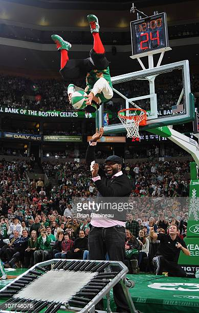 Lucky the mascot dunks the ball with the help of Boston Red Sox slugger David Ortiz during the game between the Boston Celtics and the Philadelphia...