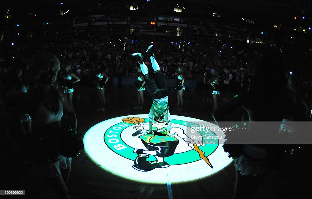 Lucky, the mascot of the Boston Celtics does a handstand at center court before the game against the Sacramento Kings on January 30, 2013 at the TD Garden in Boston, Massachusetts.