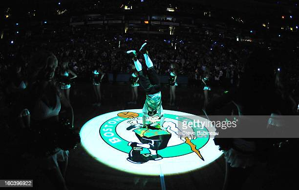 Lucky the mascot of the Boston Celtics does a handstand at center court before the game against the Sacramento Kings on January 30 2013 at the TD...