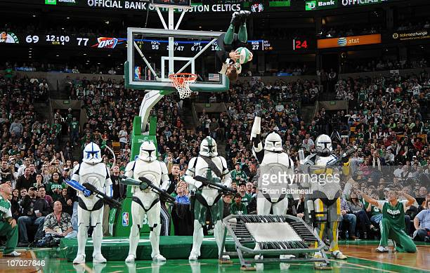 Lucky the mascot of the Boston Celtics dunks the ball over Star Wars characters during a timeout in a game against the Oklahoma City Thunder on...