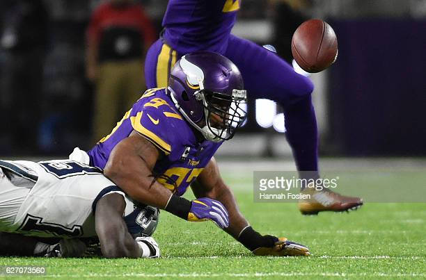 Lucky Whitehead of the Dallas Cowboys and Everson Griffen of the Minnesota Vikings scramble for a loose ball after a fumble in the second quarter of...