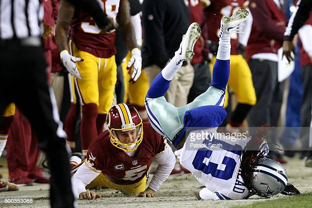 Lucky Whitehead of the Dallas Cowboys is knocked out of bounds by punter Tress Way of the Washington Redskins in the first quarter at FedExField on...