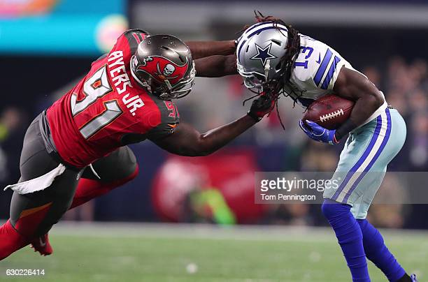 Lucky Whitehead of the Dallas Cowboys is tackled by Robert Ayers of the Tampa Bay Buccaneers during the fourth quarter at ATT Stadium on December 18...