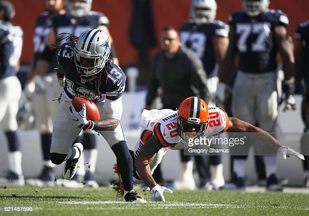 Lucky Whitehead of the Dallas Cowboys runs after the catch against Briean BoddyCalhoun of the Cleveland Browns at FirstEnergy Stadium on November 6...