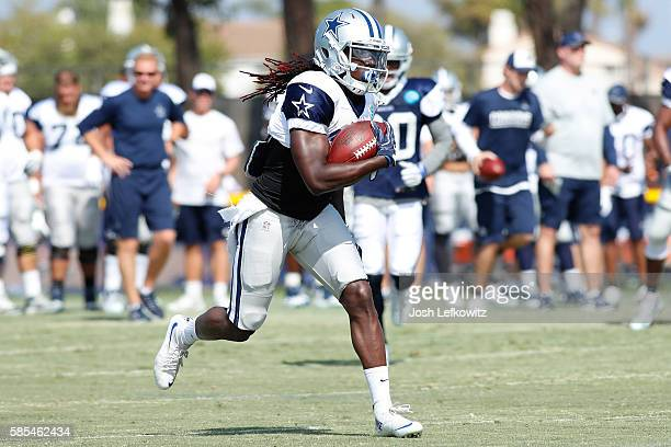 Lucky Whitehead of the Dallas Cowboys runs the ball down the field during afternoon practice on August 2 2016 in Oxnard California