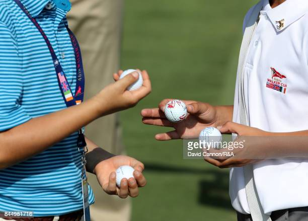 Lucky young spectators hold signed golf balls by Harry Ellis and Alfie Plant of the Great Britain and Ireland team and Collin Morikawa and Norman...