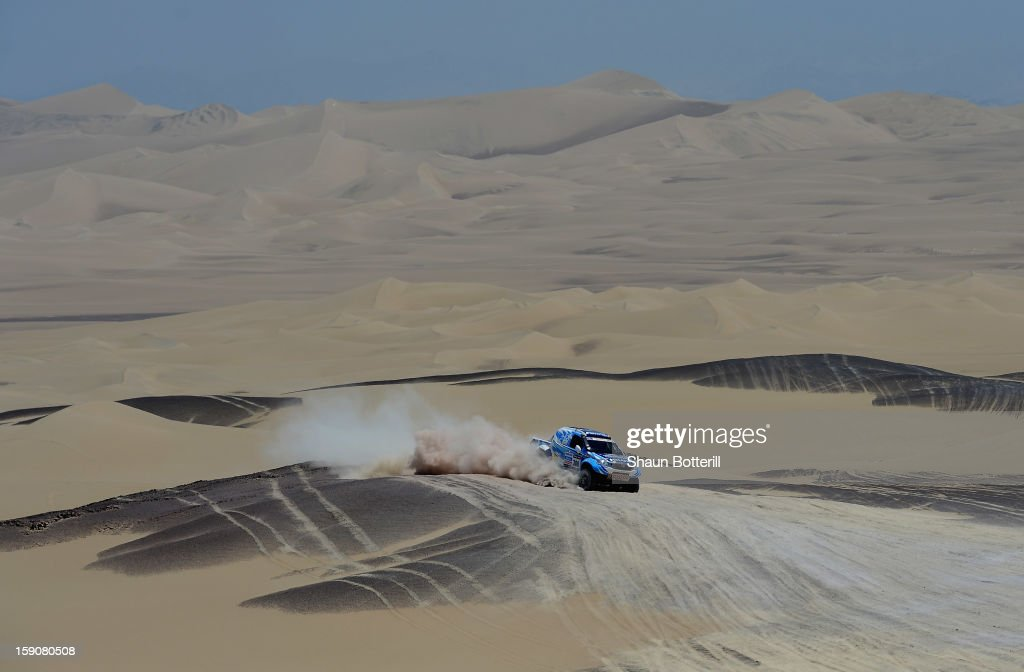 Luco Alvarez and co-pilot Ronnie Graue of team Toyota compete during the stage from Pisco to Nazca on day three of the 2013 Dakar Rally on January 7, 2013 in Pisco, Peru.