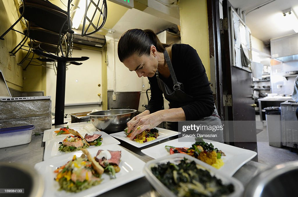 Lucques chef Suzanne Goin prepares a vegan plate in the kitchen of her restaurant Lucques to be served at the 19th annual SAG Awards during food and wine tasting event at Lucques Restaurant on January 16, 2013 in Los Angeles, California. The 19th Annual Screen Actor Guild Awards will be held at the Shrine Auditorium in Los Angeles on January 27.
