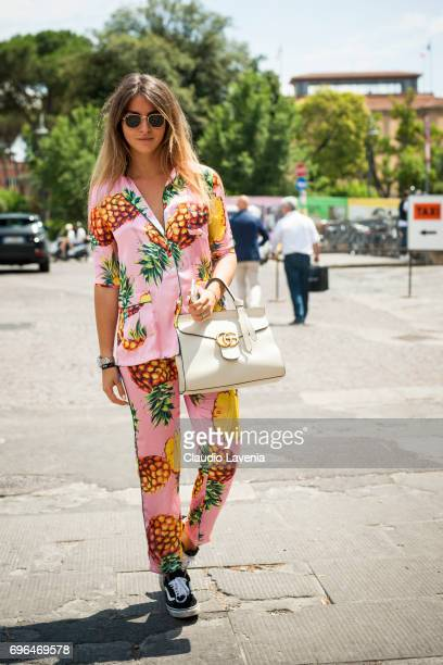 Lucrezia Trinca wears a pink pyjama with pineapple stamps and Gucci bag during Pitti Immagine Uomo 92 at Fortezza Da Basso on June 15 2017 in...