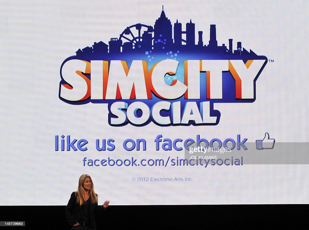 Lucy Bradshaw GM of Maxis presents Simsity integrated into Facebook during the EA (Entertainment Arts) media briefing at the E3 2012 in Los Angeles, California, on June 4, 2012. The Electronic Entertainment Expo (E3), the video game industry's biggest event, runs from June 5-7 in Los Angeles.AFP PHOTO /JOE KLAMAR