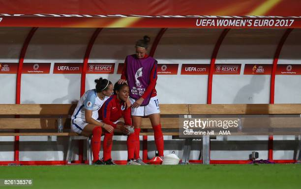 Lucy Bronze and Casey Stoney console Alex Scott of England after the UEFA Women's Euro 2017 semi final match between Netherlands and England at De...