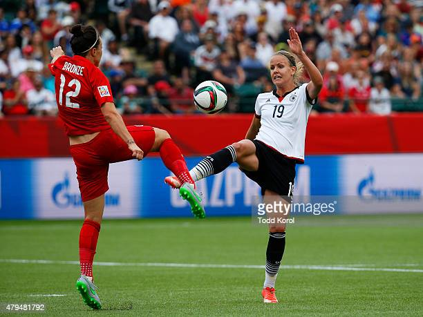 Lucy Bronze of England and Lena Petermann of Germany kick the ball during the FIFA Women's World Cup Canada 3rd Place Playoff match between England...