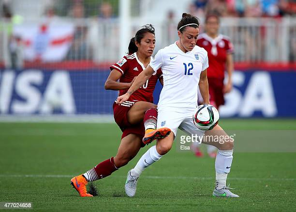 Lucy Bronze of England and Stephany Mayor of Mexico fight for the ball in the first half during the FIFA Women's World Cup 2015 Group F match at...