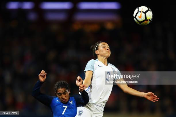 Lucy Bronze of England battles for the ball with Amel Majri of France during the International friendly match between France and Women held at Stade...