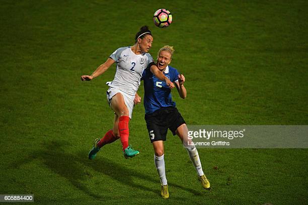 Lucy Bronze of England battles with Ragne Hindrimae of Estonia during the UEFA Women's Euro 2017 Qualifier between England and Estonia at Meadow Lane...