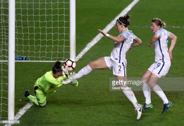 Lucy Bronze of England beats goalkeeper Manuela Zinsberger of Austria to score their second goal during the Women's International Friendly match...