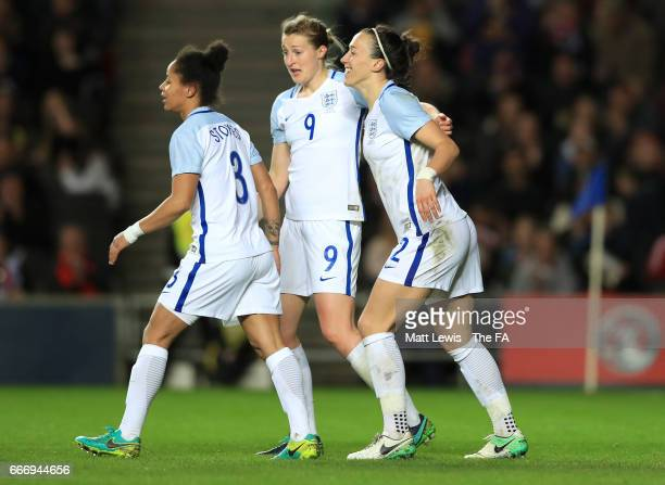 Lucy Bronze of England celebrates as she scores their second goal with Demi Stokes and Ellen White during the Women's International Friendly match...