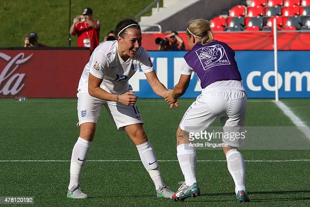 Lucy Bronze of England celebrates scoring her team's second goal with team mate Jordan Nobbs during the FIFA Women's World Cup Canada 2015 round of...