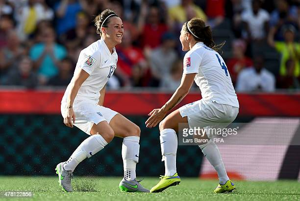 Lucy Bronze of England celebrates with Fara Williams of England after scoring her teams second goal during the FIFA Women's World Cup 2015 Round of...