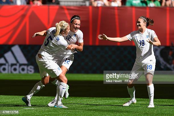 Lucy Bronze of England celebrates with team mates Steph Houghton and Jodie Taylor after scoring her team's second goal during the FIFA Women's World...