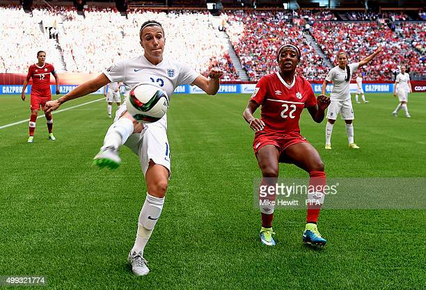 Lucy Bronze of England clears under pressure from Ashley Lawrence of Canada during the FIFA Women's World Cup 2015 Quarter Final match between...