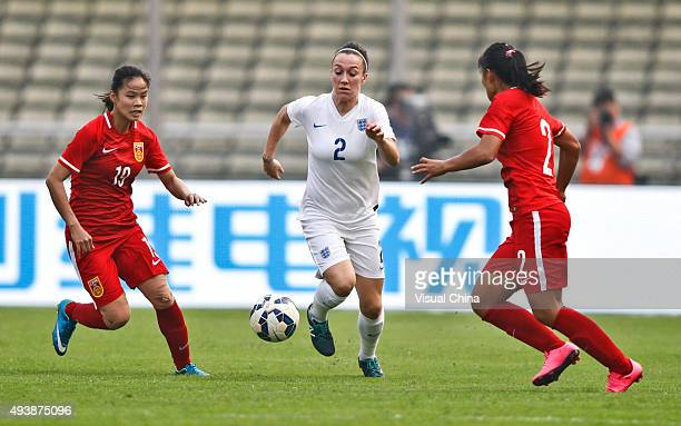 Lucy Bronze of England drives the ball in the match between China and England during the 2015 Yongchuan Women's Football International Matches at...