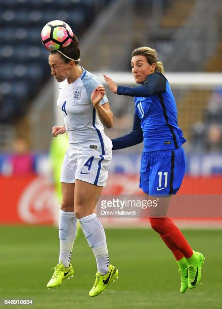Lucy Bronze of England heads the ball in front of Claire Lavogez of France during the SheBelieves Cup at Talen Energy Stadium on March 1 2017 in...