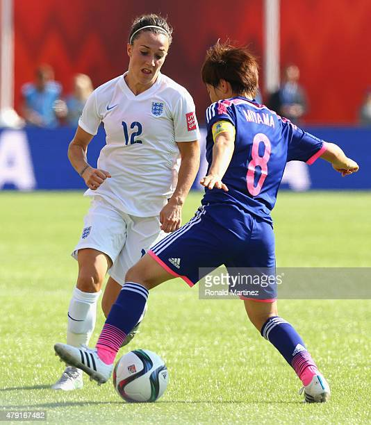 Lucy Bronze of England in action with Aya Miyama of Japan during the FIFA Women's World Cup Semi Final match between Japan and England at the...