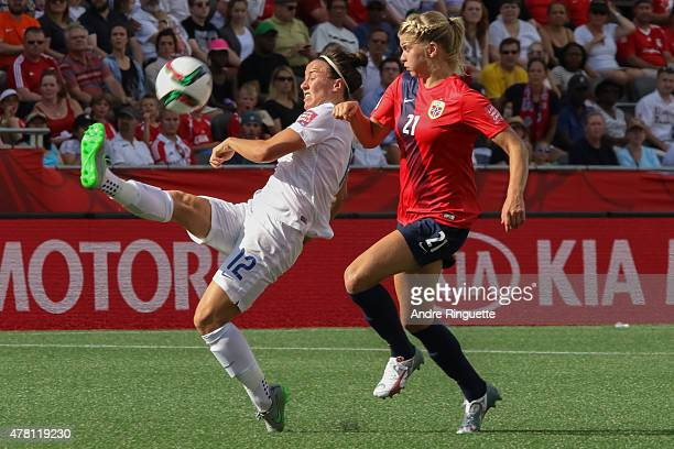 Lucy Bronze of England kicks the ball away from Ada Hegerberg of Norway during the FIFA Women's World Cup Canada 2015 round of 16 match between...