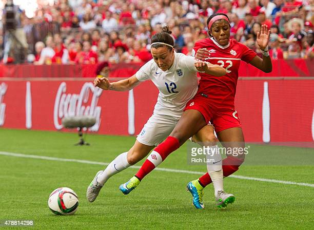 Lucy Bronze of England knocks Ashley Lawrence of Canada off the ball during the FIFA Women's World Cup Canada 2015 Quarter Final match between the...