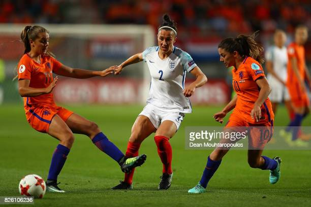 Lucy Bronze of England passes under pessure from Lieke Martens and Danielle van de Donk of The Netherlands during the UEFA Women's Euro 2017 Semi...