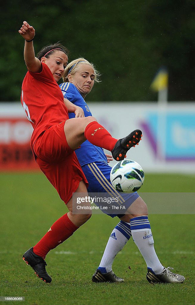 Lucy Bronze of Liverpool battles with Edda Gardarsdottir of Chelsea during the FA WSL match batween Chelsea Ladies FC and Liverpool Ladies FC at Wheatsheaf Park on May 12, 2013 in Staines, England.
