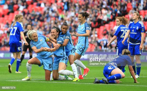 Lucy Bronze of Manchester City celebrates scoring her sides first goal with her Man City team mates during the SSE Women's FA Cup Final between...