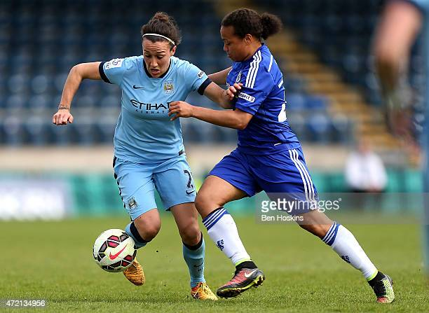 Lucy Bronze of Manchester City holds off the challenge of Eniola Aluko of Chelsea during the Women's FA Cup Semi Final match between Chelsea Ladies...