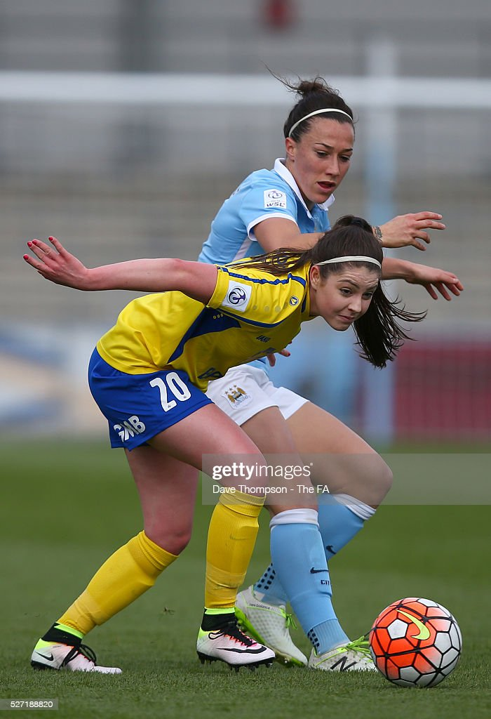 Lucy Bronze of Manchester City Women and Carla Humphrey of Doncaster Belles during the game between Manchester City Women and Doncaster Belles at the Manchester City Academy Stadium on May 2, 2016 in Manchester, England.