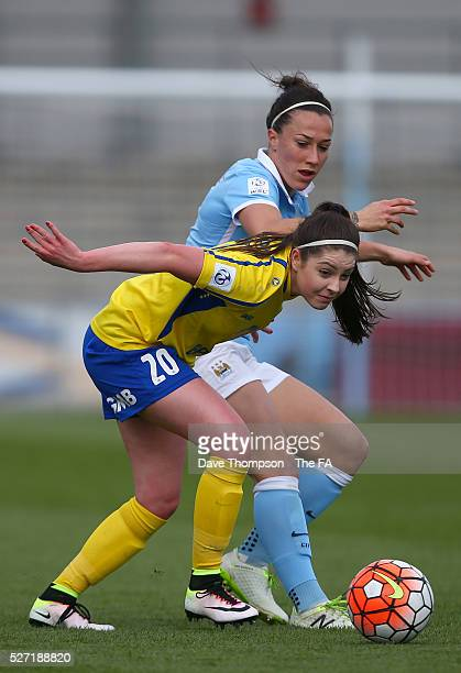 Lucy Bronze of Manchester City Women and Carla Humphrey of Doncaster Belles during the game between Manchester City Women and Doncaster Belles at the...