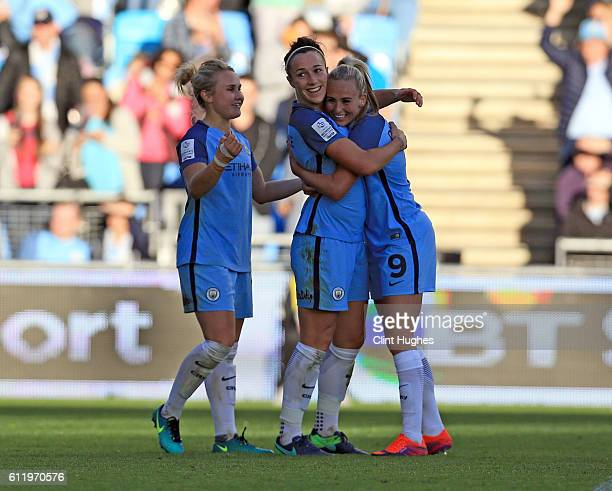 Lucy Bronze of Manchester City Women celebrates with teammates Toni Duggan and Izzy Christiansen after she scores her sides first goal during the...