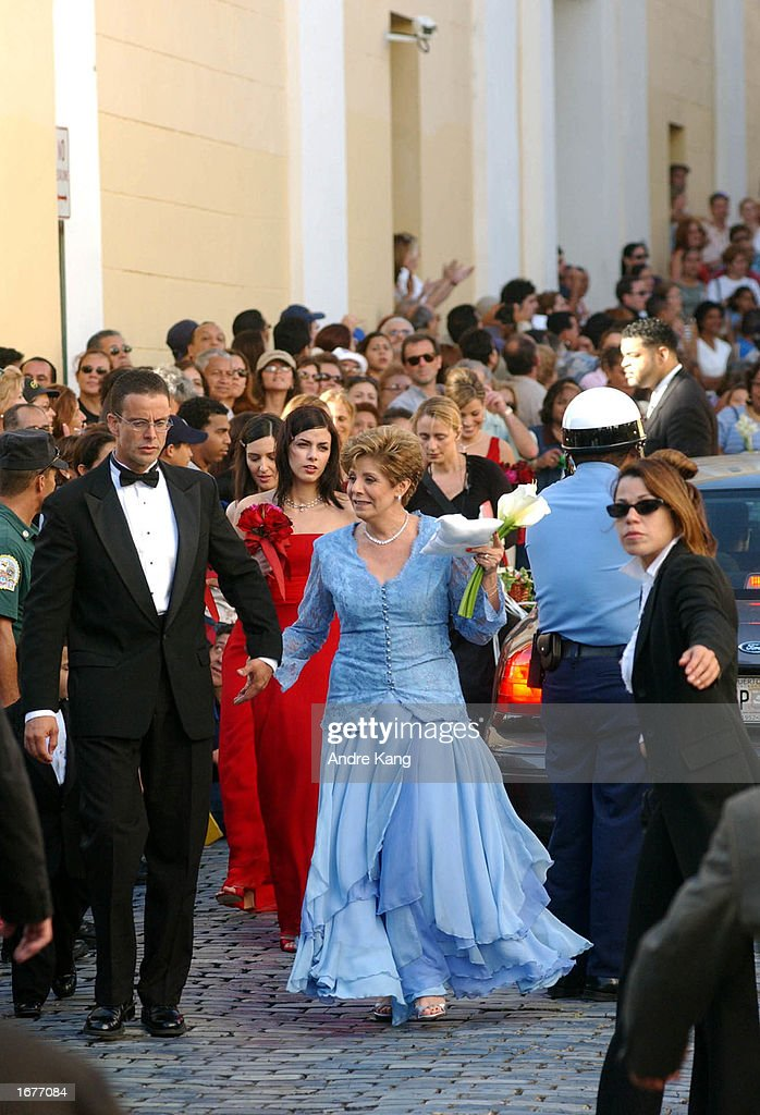 Lucy Delagdo (C), mother of 1993 Miss Universe Dayanara Torres, arrives at the Old San Juan Cathedral for singer Marc Anthony and wife Dayanara Torres' Catholic wedding December 7, 2002 in San Juan, Puerto Rico.
